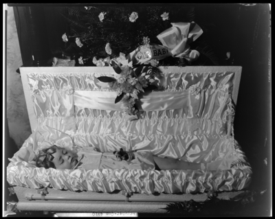 Jeanette Grace Waggoner, 641 West Short; corpse; open casket                             surrounded by flowers