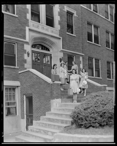 Moorhead College; Allie Young Hall; building, exterior; group of                             women standing on the steps leading to building