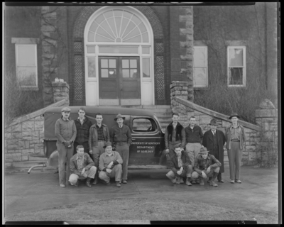 Sigma Gamma Epsilon group standing outside the Administration                             Building; Department of Geology automobile in background; (1943                             Kentuckian) (University of Kentucky)