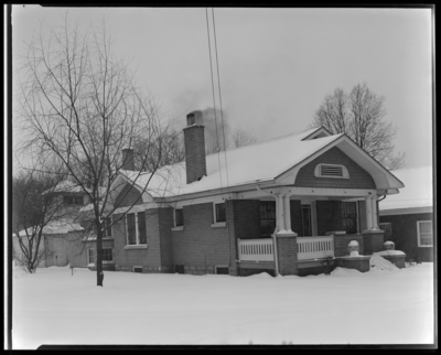 Mr. and Mrs. R.J. Long (Lafayette Studios); home, h928 Idlewild                             Court ; snow scene