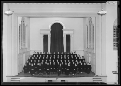 Combined Glee Club standing on stage of Memorial Hall; University                             of Kentucky