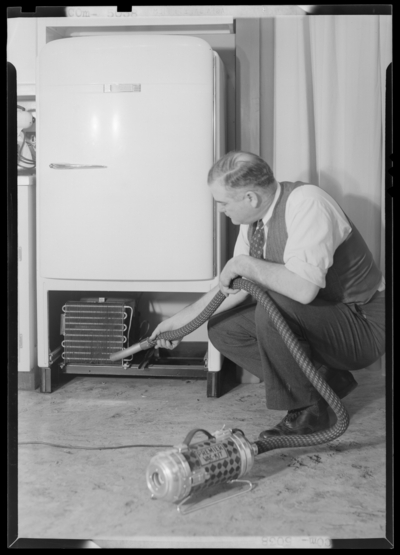 Kentucky Utilities Company (167 West Main Street); man working on                             ice box