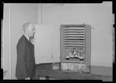 Kentucky Utilities Company (167 West Main Street); man standing                             next to hydrator