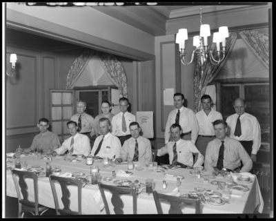 R.B. Robins; victory garden; group of men sitting around                             table