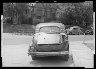 Lexington Yellow Cab Company, 150 North Limestone; wrecked                             cab