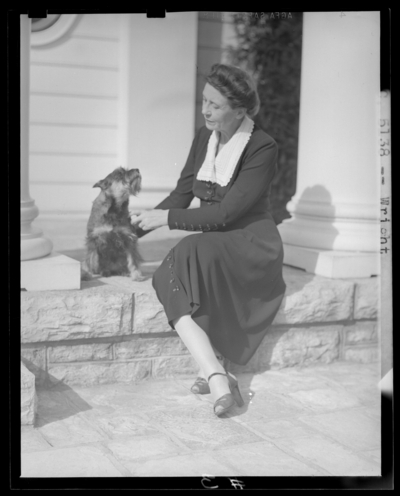 Mrs. Warren Wright with dog