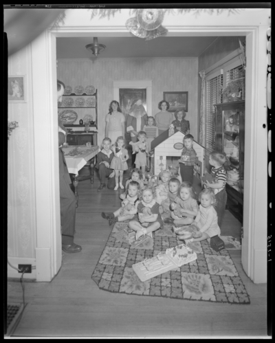 Mrs. E.J. Reynolds; childrens' Christmas party; children in                             house