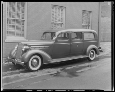 W.R. Milward (Funeral Home) (159, 161, 163, 165 North Broadway);                             ambulance parked at exterior of building