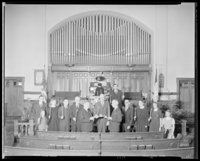 Park Methodist Church, 645 East High; interior; group standing at                             alter