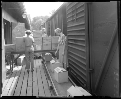 National Distillers Corporation; packing department, women                             working on assembly line