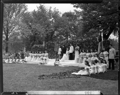 Georgetown College; May Day Celebration; outdoors; Queen sitting                             on stage with her court