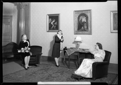 Cardome Academy; bookshelf; women sitting in room