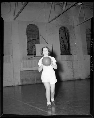 Georgetown College; gym (gymnasium); interior; woman with                             basketball