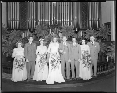 Mr. & Mrs. Richard Wall; wedding; interior; wedding                             couple (bride and groom) standing with bridesmaids and best                             men