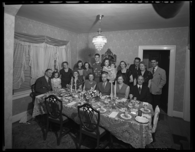 R.J. Long (Lafayette Studios); Thanksgiving Dinner; group                             gathered around the dinner table; group portrait