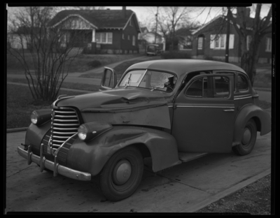 R.J. Long (Lafayette Studios); 928 Idlewild Court; wrecked                             (damaged) car parked in driveway