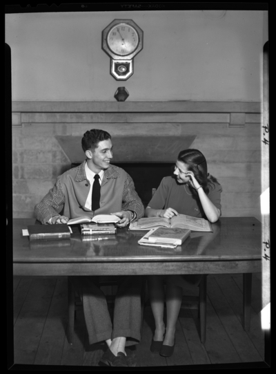 Georgetown College; library; interior; two students sitting at a                             table