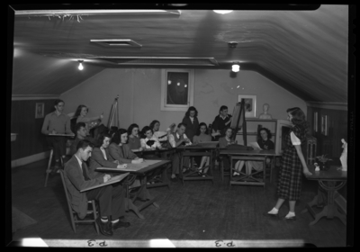 Georgetown College; Kappa Pi Art Room; interior; group drawing                             model standing next to table