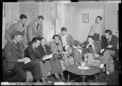 Georgetown College; Pauling Hall; interior; group of men gathered                             around the lounge
