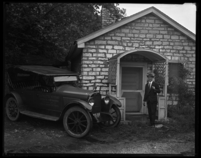 R.J. Long (Lafayette Studios); standing outside of building with                             the Lafayette Studios car