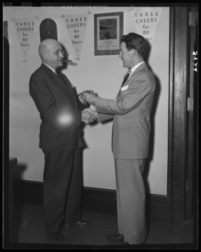 National Life & Accident Insurance Company, 167 West                             Main; First National Bank and Trust Company, 167 West Main; interior;                             man receiving a pin from another man