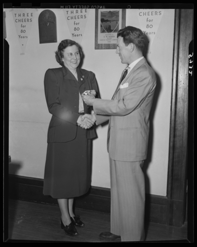 National Life & Accident Insurance Company, 167 West                             Main; First National Bank and Trust Company, 167 West Main; interior;                             woman receiving a pin from a man