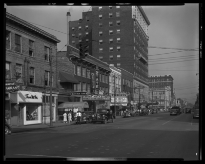 East Main, between Esplanade and Walnut (now Martin Luther King),                             south side; 226 through 200 East Main; visible are Thom McAn Shoe Store                             (226 E. Main), Mayfair Bar (224 E. Main), State Theatre (220 E. Main,                             marquee lists