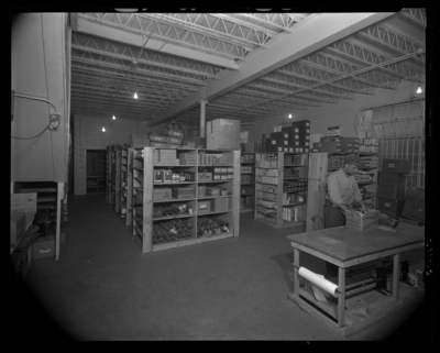 Kay Surgical Incorporated (medical supply), 242 Jefferson;                             interior; office; stockroom; man packing a box
