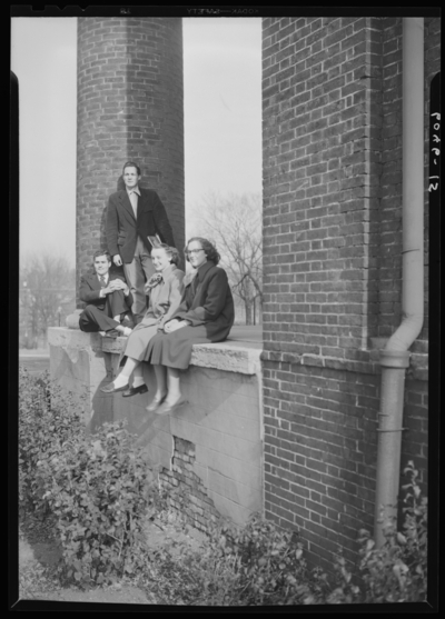 Belle of the Blue; Georgetown College; exterior; group sitting on                             wall of building