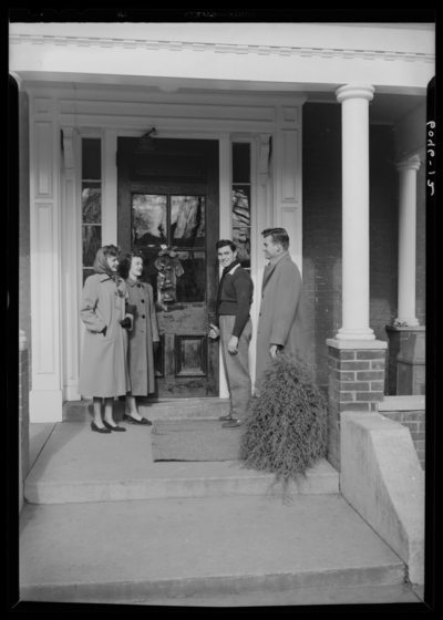 Belle of the Blue; Georgetown College; exterior; group standing                             next to building entranceway