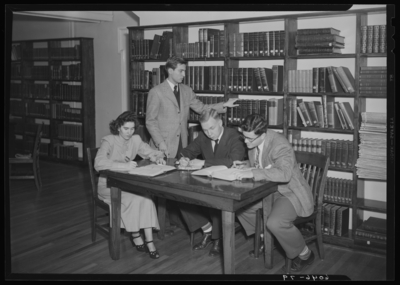 Belle of the Blue; Georgetown College; library; interior; group                             gathered around a table