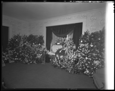 Ida Mae Ayers; corpse; open casket surrounded by                             flowers