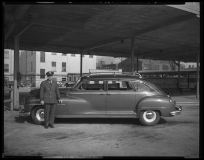 All-American Tour; Bus Terminal; exterior; chauffeur standing                             next to car