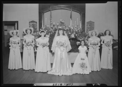 Tuttle, Mr. & Mrs. Fred; wedding; church; interior;                             bride, bridesmaids, and flower girl