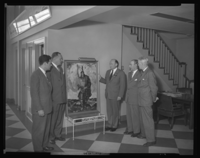 Charlie Sturgill Motor Company, 109-111 Rose; presentation of                             picture; group of men standing beside painting depicting an American                             Indian