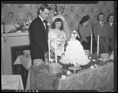 Mr. & Mrs. Ronald Lee Cole; wedding; interior; bride and                             groom cutting wedding cake