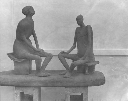Two ceramic sculptures by John Tuska. Both sculptures are of human figures sitting on stools