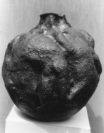 A ceramic spherical shaped vase by John Tuska