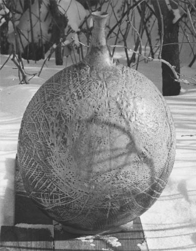 A ceramic vase sitting in the snow, a piece of John Tuska's Alfred University graduate work