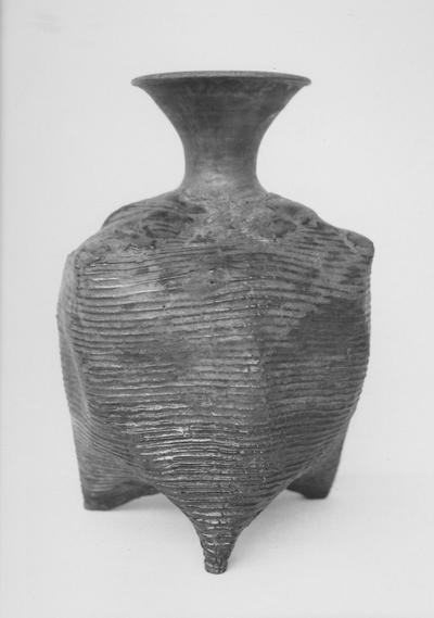 A ceramic vase with horizontal lines by John Tuska