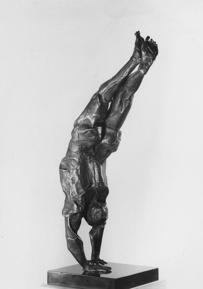 A bronze sculpture with a black Belgian marble base entitled