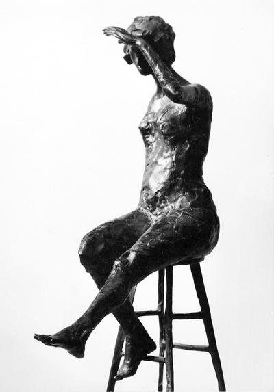 A bronze sculpture of a female nude entitled
