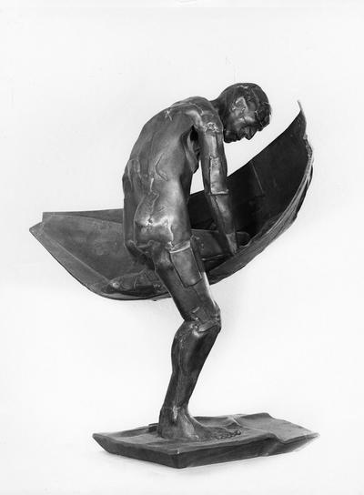 A bronze sculpture of a male nude entitled