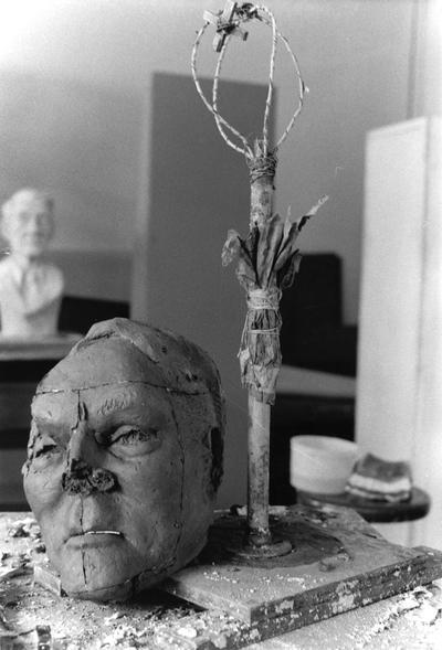 An image of the armature and a damaged clay John Sherman Cooper bust by John Tuska