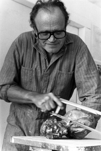 John Tuska cutting the spews off of a John Sherman Cooper bust study