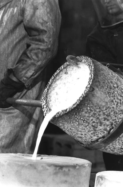The crucible containing the bronze being poured in the mold for the John Sherman Cooper bust