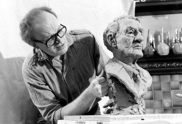 John Tuska working on a clay bust study of the John Sherman Cooper bust