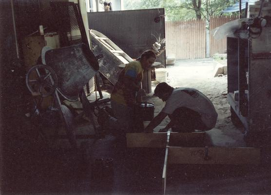 Scott Oberlink and Andrew Marsh making sand molds in the University of Kentucky foundry for the casting