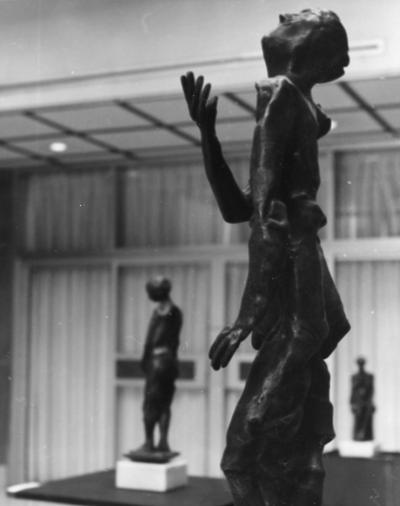 Three bronze figure sculptures at an exhibit in the Spindletop Research Center