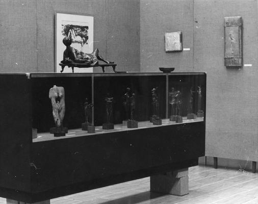 A case of sculptures with a bronze figure sculpture entitled